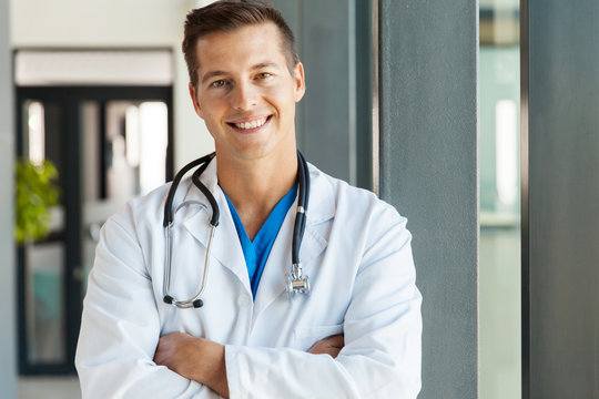 young male doctor looking at the camera