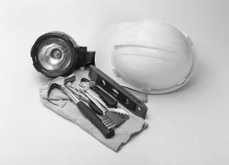 construction equipment  hat ,hammer flashlight on a white background