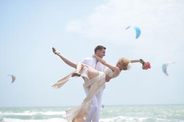 Pretty wedding pair on beach