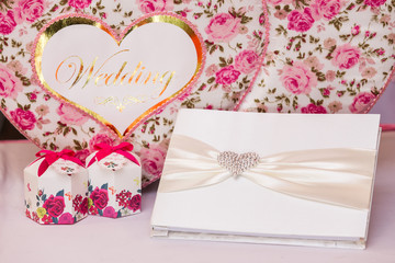 Wedding guest book and wedding box on pink silk