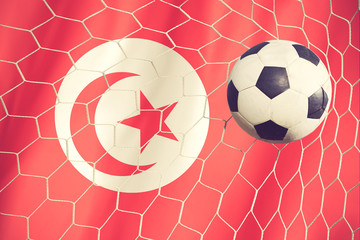 Soccer ball on the tunisia flag vintage color