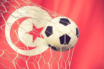 Soccer ball on the tunisia flag vintage color