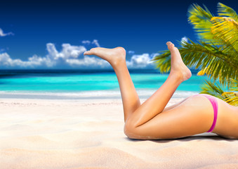Woman is lying on the tropical beach