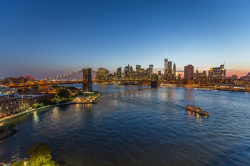 New York City Brooklyn Bridge buildings evening sunset skyline