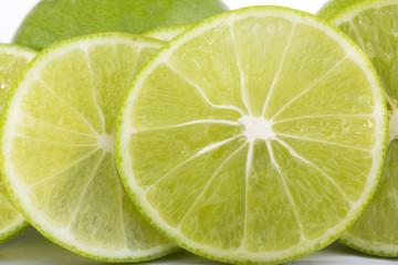 lime slice and lemon on white background