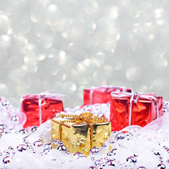 Christmas background with red and golden gifts