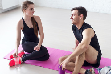 Sport connecting people friends relaxing after workout girl