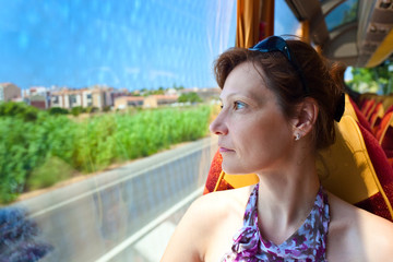 woman in the bus looks out of the window
