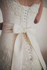 Beautiful luxury lace wedding dress and white bow