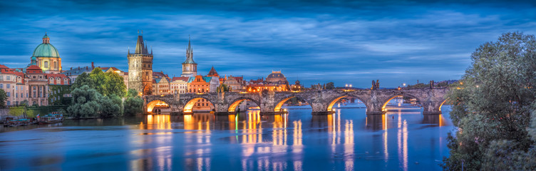 Foto op Plexiglas Praag Prague at night Charles Bridge to the river and the old town center/The historic center of Prague, ancient architecture, and cultural heritage