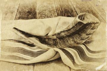 shofar (horn) on white prayer talit. jewish holiday concept