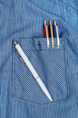 Shirt and colorful pens