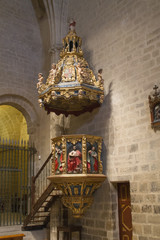 Ornate wood carved pulpit in the 14th century Romanesque chuch of Santa Maria la Blanca.Ujue,Spain