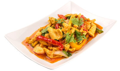 Malaysian traditional dish of Ayam Paprik or spicy stir fry chicken on white plate over white background