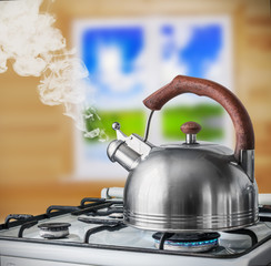 kettle boiling on the gas stove in the kitchen