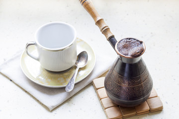 Cezve of turkish coffee and cup