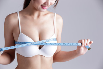 young woman checking breast measurement