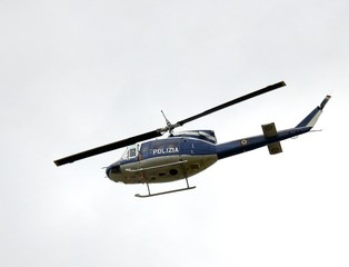 Italian police helicopter flying over the city