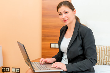female 30 years, working on a laptop on a business trip