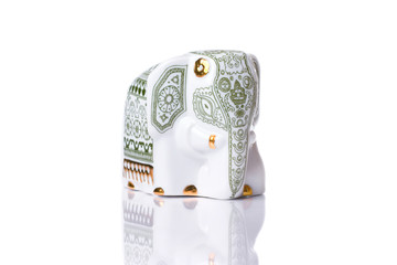 Beautiful porcelain elephant isolated with reflection
