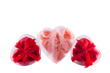 Three hearts from pink and red roses with bows