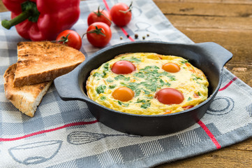 Frittata (italian omelet) with paprika and cherriy tomatoes. Direct view