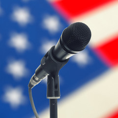 Microphone on stand with US flag - studio shot
