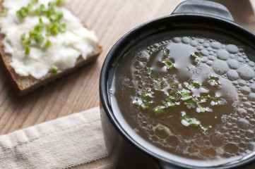 Mushroom soup served with lard spread with green onion