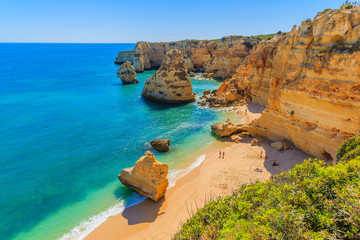View of beautiful Marinha beach with crystal clear turquoise water near Carvoeiro town, Algarve region, Portugal Fototapete