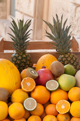 Group of mediterranean fruits set on the table of a seller along the streets of Ortigia, the old Syracuse
