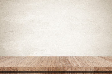 Empty wooden table over grunge cement wall background