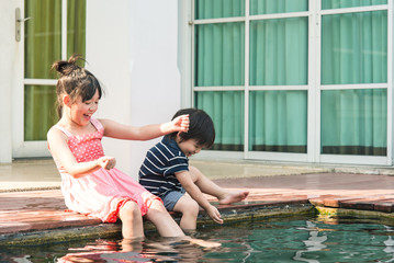 Asian children splashing around