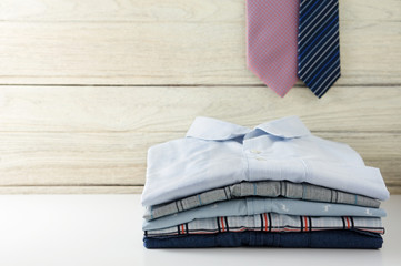 Stack of men shirts with tie
