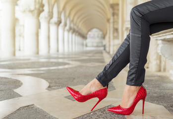 Woman in Venice wearing red high heel shoes