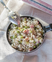 Lemon risotto with bacon and peas close up