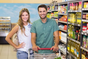 Portrait of smiling bright couple buying food