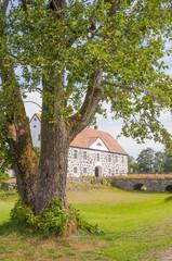 Hovdala Slott behind tree