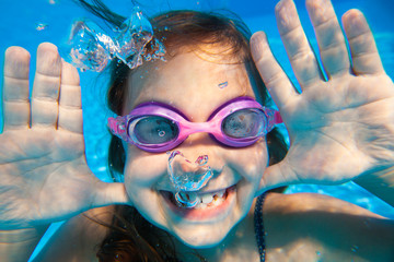 Underwater portrait of girl