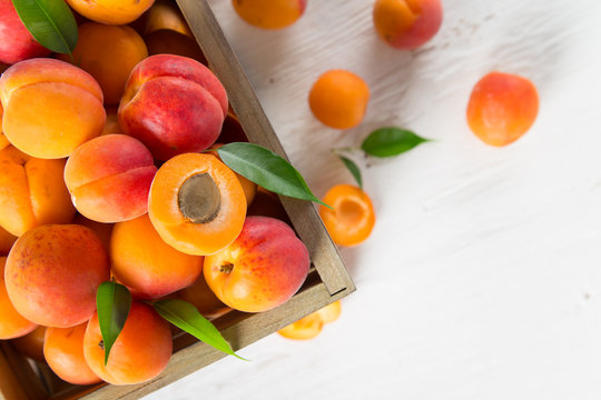 Fresh apricots on wooden table, close-up.
