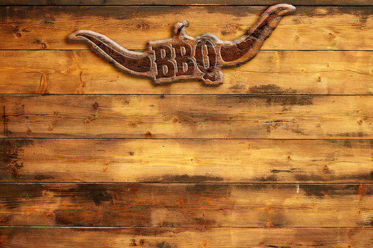 """plaque """"bbq"""" nailed to a wooden board"""