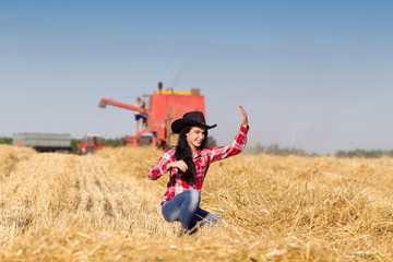 Cowgirl in wheat field