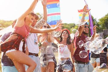 Friends enjoying a performance at a music festival