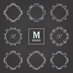 Filigree frames set on blackboard. Monogram design.
