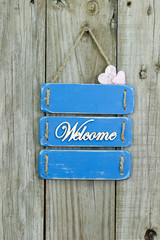 Welcome sign with painted wood hearts