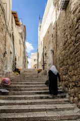 Woman walking in Jerusalem old city