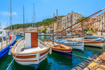 Colorful typical fishing boats in Bonifacio port, Corsica island, France