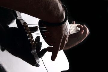 Wall Mural - Acoustic guitar close-up with fingers playing it