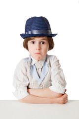 The confusion boy with expressive face in the blue hat