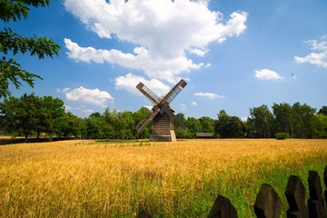 Agricultural summer landscape with old windmill