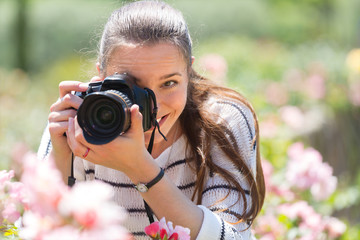 Girl with photocamera at park